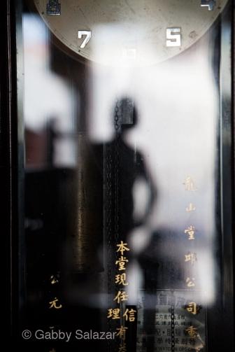 Reflection in a clock, Leong San Tong Khoo Kongsi, Georgetown, Penang, Malaysia