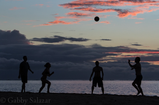 Rick and his classmates play ball on La Preneuse Beach at sunset in Mauritius.