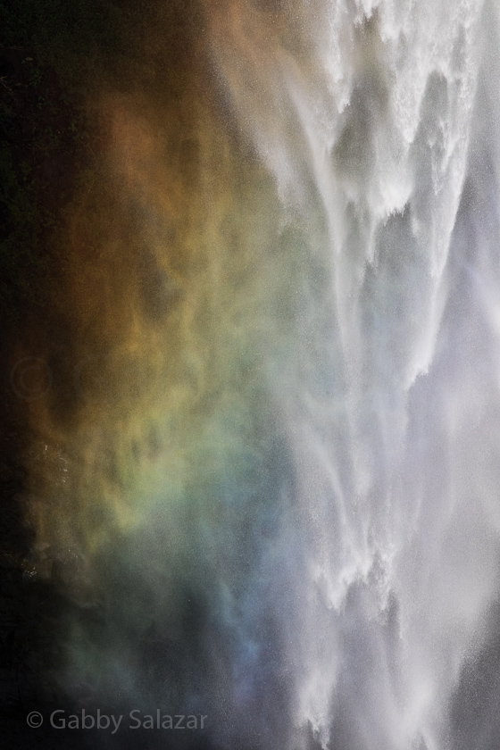 A rainbow spreads across the Chamaral Waterfall in Black River, Mauritius.